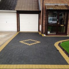 paving a driveway with pavers