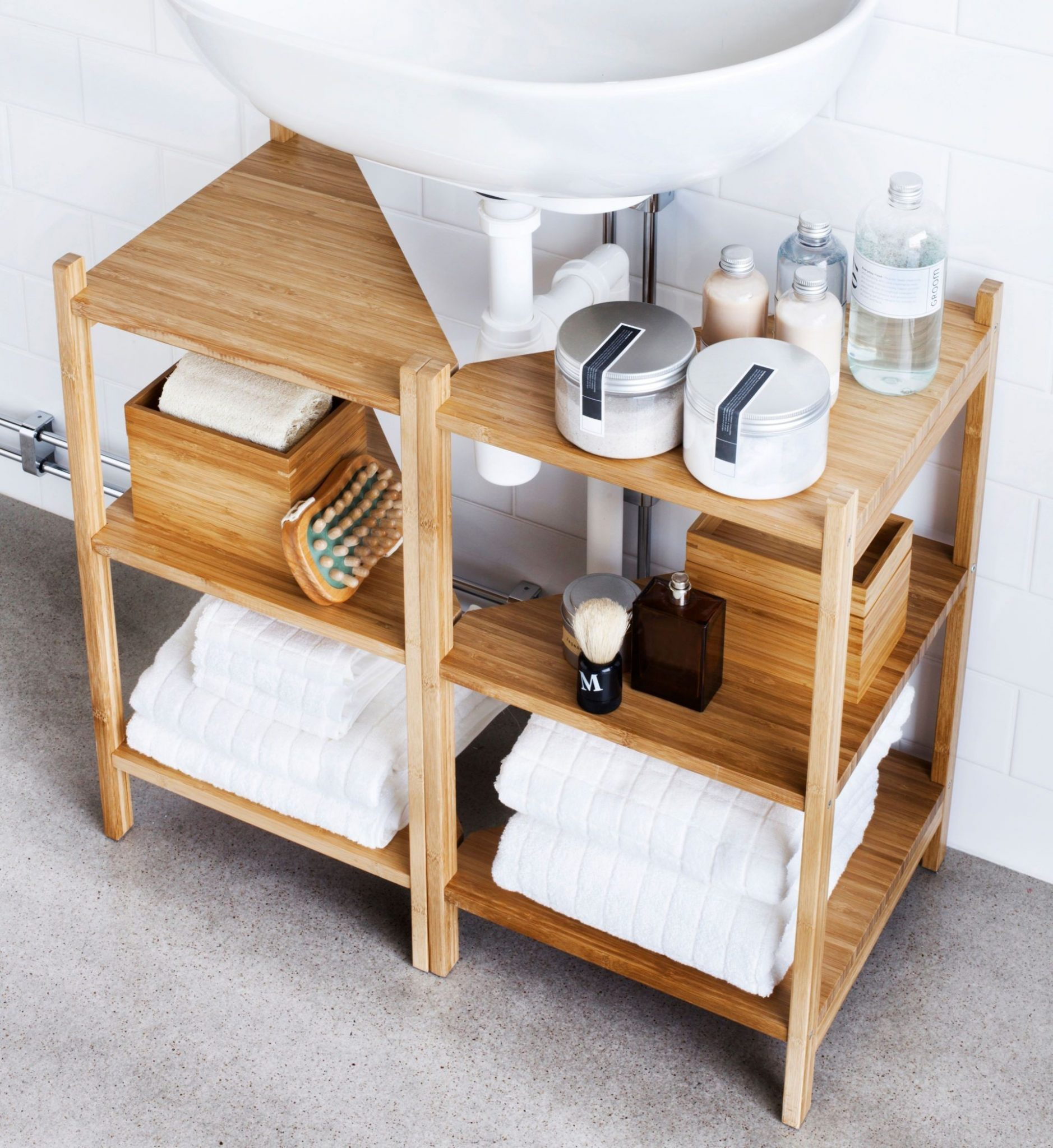 below pedestal sink storage